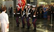 Ambassador Pettit, marching Color Guard, and a group of guests.